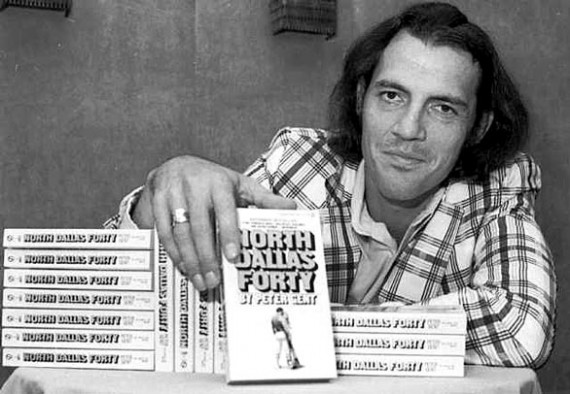 """Former Dallas Cowboys flanker and author Peter Gent poses with copies of his bestseller, """"North Dallas Forty,"""" in New York. (Associated Press / August 26, 1974)"""