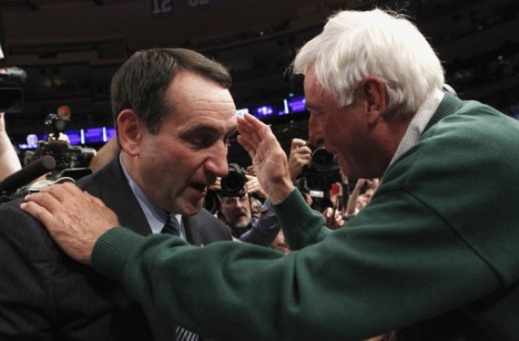 Duke head coach Mike Krzyzewski (L) is embraced by his mentor former Indiana coach Bobby Knight after Duke defeated Michigan State in their NCAA men's basketball game in New York November 15, 2011. The win was Krzyzewski's 903rd, surpassing Knight's record as the most wins ever as a college coach.
