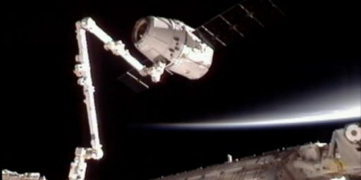 SpaceX Capsule 'Dragon' Docks With International Space Station