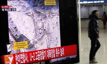 A passenger walks past a television report on North Korea's nuclear test at a railway station in Seoul