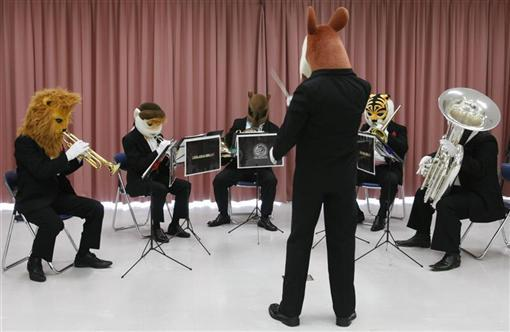 Professional musicians wearing animal masks perform at the Zoorasia zoo in Yokohama