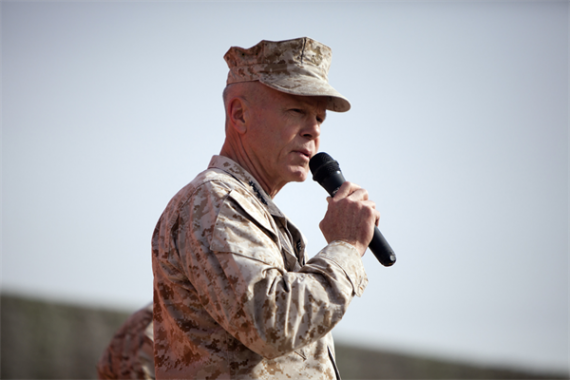 Commandant of the Marine Corps, Gen. James F. Amos, addresses a crowd of U.S. Marines and Sailors at Camp Leatherneck, Afghanistan Dec. 23. Amos expressed his admiration to the service members for their accomplishments and dedication to supporting the ongoing counterisurgency mission, especially while deployed during the holiday season.