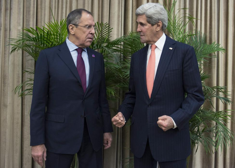 U.S. Secretary of State John Kerry and Russian Foreign Minister Sergei Lavrov meet on the sidelines of the Asia-Pacific Economic Cooperation (APEC) meeting in Beijing