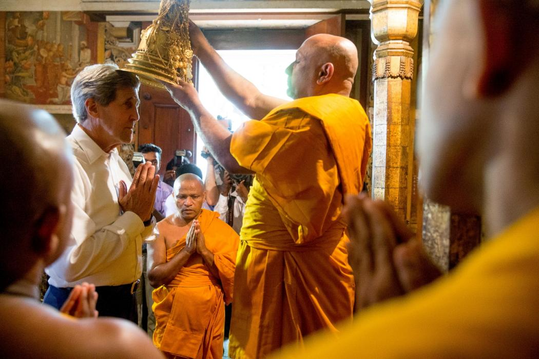 Head monk Venerable Professor Sangharakkhita Mahathera performs a health and happiness blessing on U.S. Secretary of State Kerry inside the ancient Kelaniya Temple in Colombo