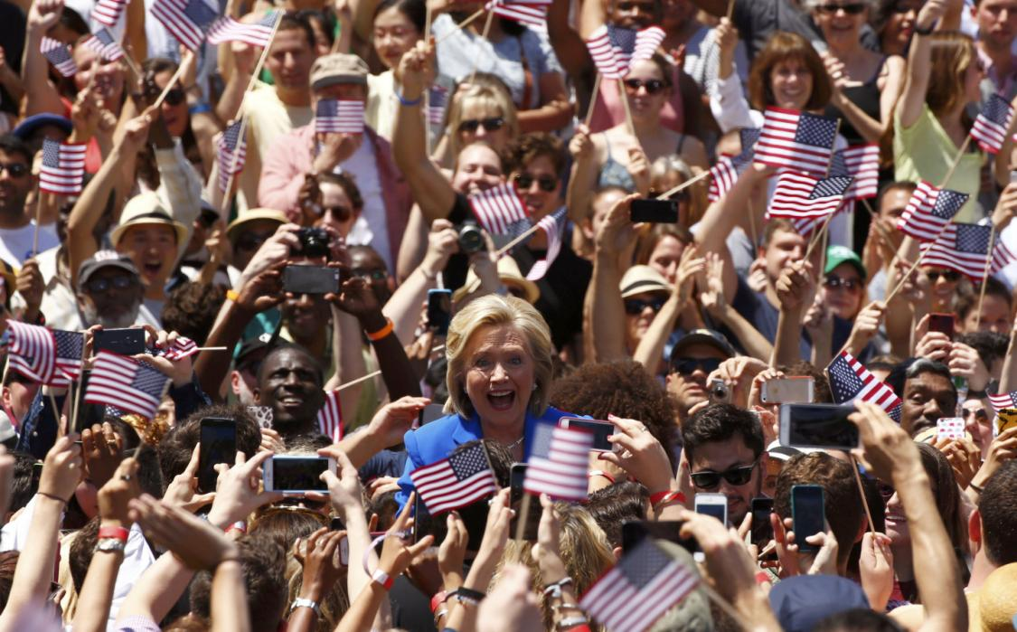 """U.S. Democratic presidential candidate Hillary Clinton takes the stage to deliver her """"official launch speech"""" at a campaign kick off rally in New York"""