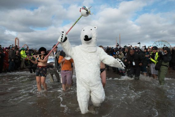 A man dressed as a polar bear walks into the ocean during the annual Coney Island Polar Bear Club New Year's Day swim on January 1, 2016 in the Brooklyn borough of New York City. The Coney Island Polar Bear Club claims to be the oldest winter bathing organization in the U.S. and attracts hundreds to the beach for the annual swim in the Atlantic Ocean. (Stephanie Keith/Getty Images)