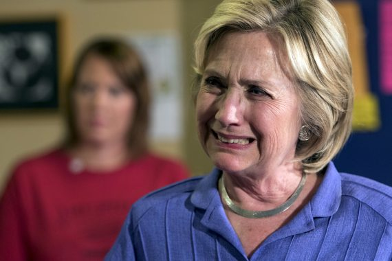 Democratic presidential candidate Hillary Clinton reacts as she listens to a question from the audience during a campaign event at Uncle Nancy's Coffee in Newton, Iowa, September 6, 2015. REUTERS/Scott Morgan - RTX1RDSX
