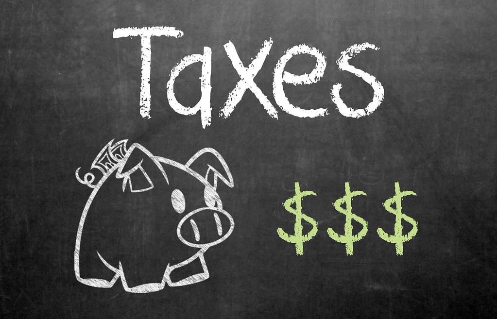 tax taxes pig piggybank dollar signs chalkboard