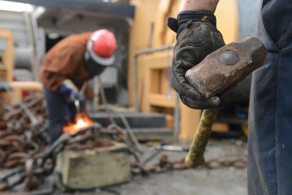 photo of working, person, military, construction, cutting, team, helmet, build, labor, job, workers, laborer, task, construction worker, sledge hammer