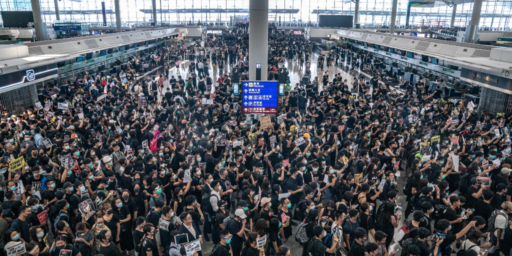 Hong Kong Protests Close Airport, Risk Confrontation With Military