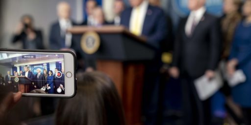 President Donald J. Trump is seen on a cellphone screen as he addresses his remarks at a White House Coronavirus Taskforce update briefing Monday, March 9, 2020, in the James S. Brady Press Briefing Room of the White House. (Official White House Photo by D. Myles Cullen)