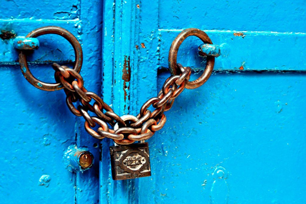 blue door chained and locked