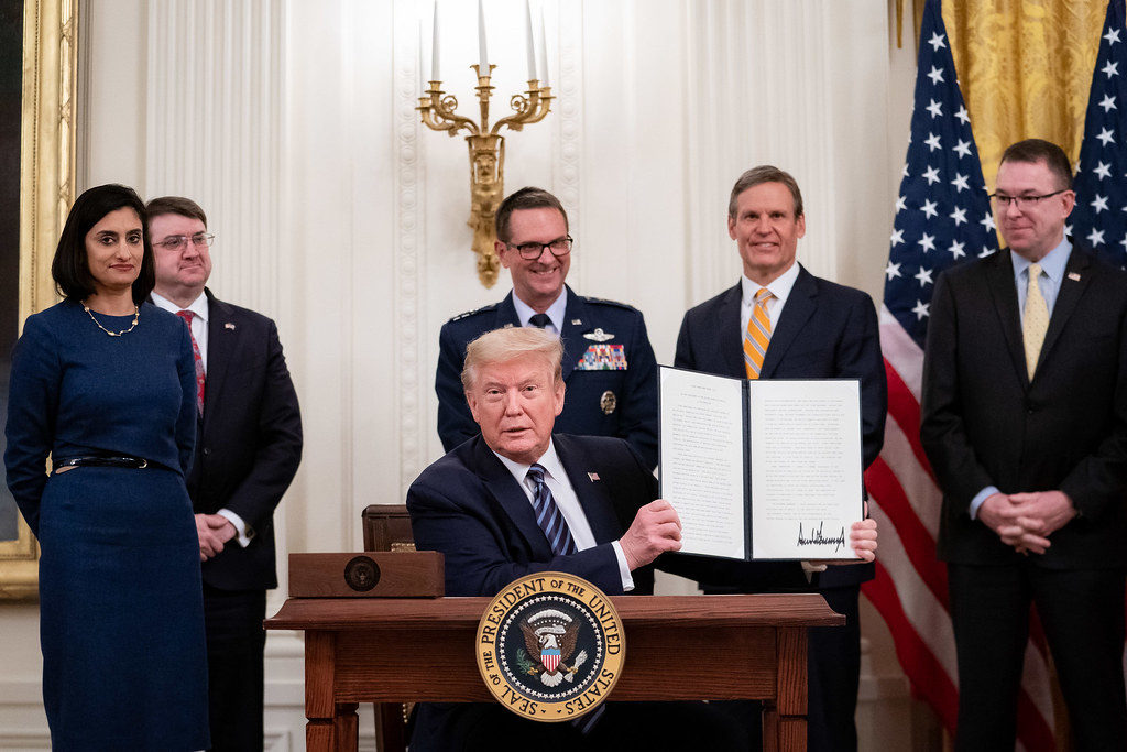 President Donald J. Trump displays his signature on a proclamation making the month of May Older Americans Month, during the America's Seniors event Thursday, April 30, 2020, in the East Room of the White House. (Official White House Photo by Tia Dufour)