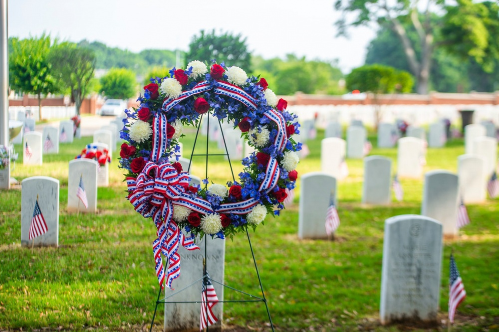 """Fort Benning honors the nation's fallen service members with a Memorial Day ceremony at the post's cemetery May 27. The 9 a.m. ceremony at the Main Post Cemetery went forward under bright but partly cloudy skies, with an audience of some 200 Soldiers and civilians seated outdoors. The ceremony included remarks by a speaker, and a wreath-laying in tribute to """"all the nation's veterans who made the ultimate sacrifice."""" The wreath-laying was followed by the firing of a three-volley rifle salute and the playing of """"Taps."""" (U.S. Army photos by Patrick Albright, Maneuver Center of Excellence, Fort Benning Public Affairs)"""