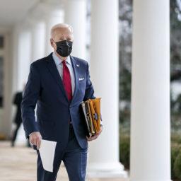 President Joe Biden walks along the Colonnade of the White House Thursday, Jan. 28, 2021, en route to the Oval Office.