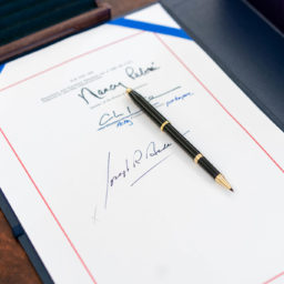 "The signatures of House speaker Nancy Pelosi, Senator Majority Leader Charles ""Chuck"" Schumer and President Joe Biden are seen on the ""American Rescue Plan Act of 2021"" Thursday, March 11, 2021, in the Oval Office of the White House."