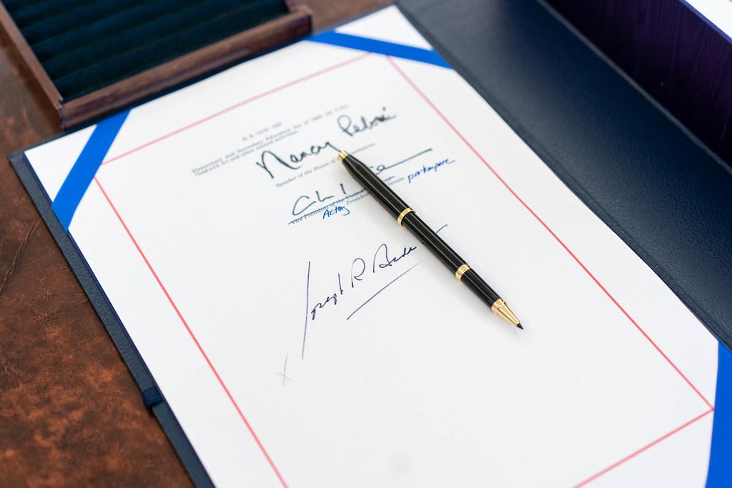 The signatures of House speaker Nancy Pelosi, Senator Majority Leader Charles