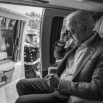 A U.S. Marine opens the door as President Joe Biden prepares to disembark Marine One, Saturday, July 3, 2021, at Antrim County Airport in Bellaire, Michigan. (Official White House Photo by Adam Schultz)